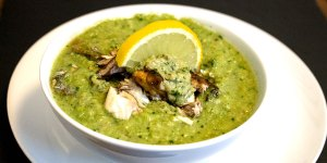 bowl of fishy looking green soup