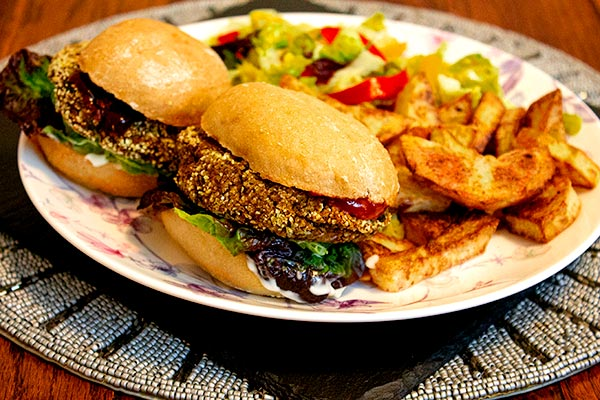 Oven baked black bean burgers with oven chips and salad