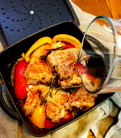 Take out of the oven and pour in the wine. Mix around as best you can.