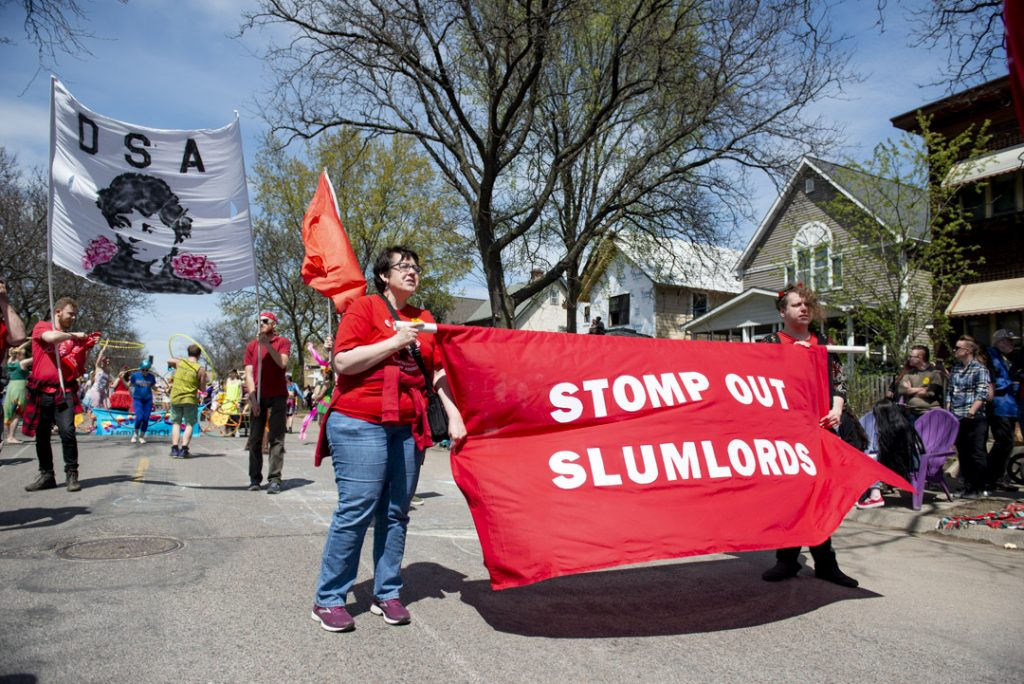 The Twin Cities DSA marching in the May Day parade