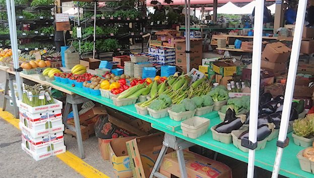A booth with fresh produce at the Minneapolis Farmers' Market.