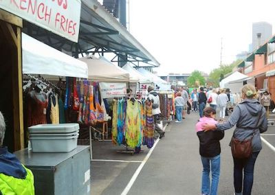 Vendors line the aisles at the Farmers' Market Annex.