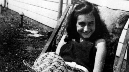 Anne Frank outside in casual clothes