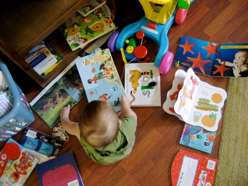 Baby surrounded by books