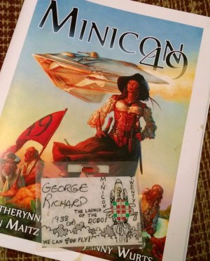 My first MiniCon badge (Minicon 27) and the Minicon program book from MiniCon 49