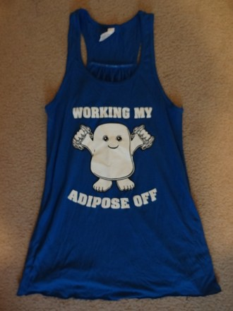 "A workout tank with an image of an Adipose from Doctor Who and the words ""WORKING MY ADIPOSE OFF"""