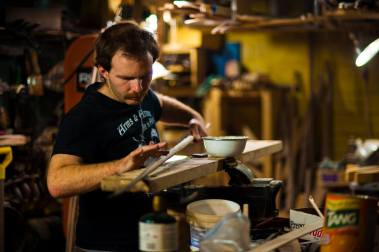 Cameron working in his shop