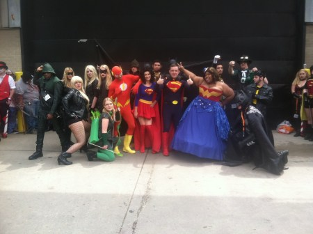A group of superhero cosplayers pose for a photo