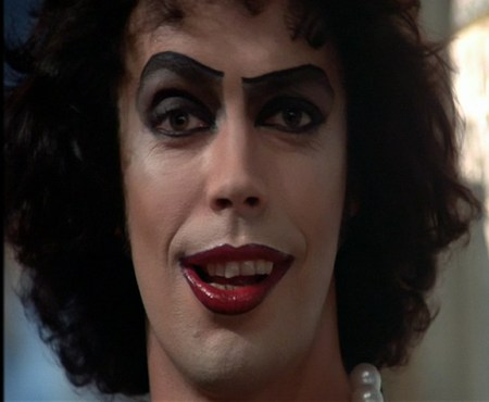 Tim Curry portraying Frank-N-Furter