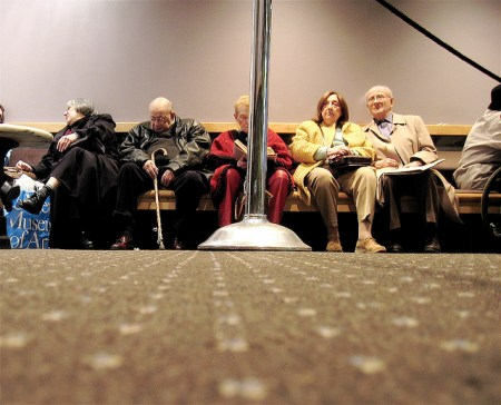 Older moviegoers in a matinee line.