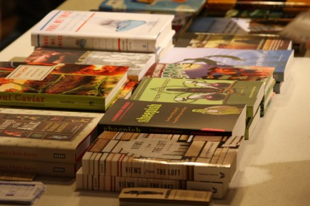 A table with stacks of books