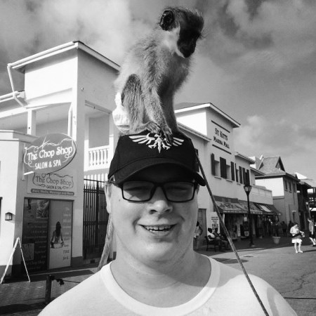 Photo of Adam Haverkamp with a monkey on his head
