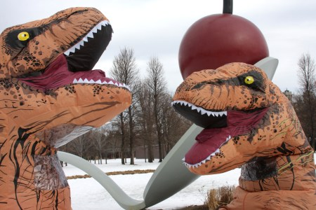 Two T-Rexes in profile near the Spoonbridge Cherry statue