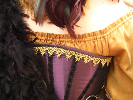 Wine-colored corset with gold embellishments