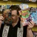 Christopher Jones at Source Comics and Games holding some comics he drew