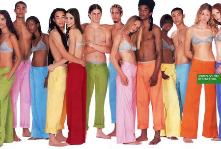 An ad for United Colors of Benetton featuring men and women of different races