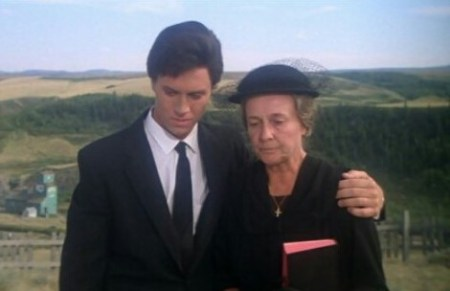 Clark with his arm around Martha, dressed for Jonathan's funeral