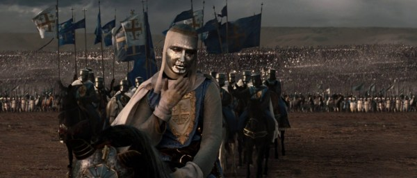 During the Parlay, the character at the forefront has a golden helmet that shows facial features. Behind him are other knights on horses, and way in the background...thousands of people.