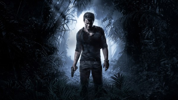 Nathan Drake stands with his gun at his side