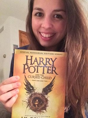 The author, Mariah Kaercher, smiling and holding Harry Potter Cursed Child