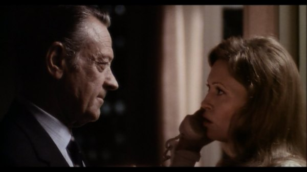 William Holden and Faye Dunaway in Network.