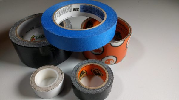 An image of five rolls of adhesive tape, all different.