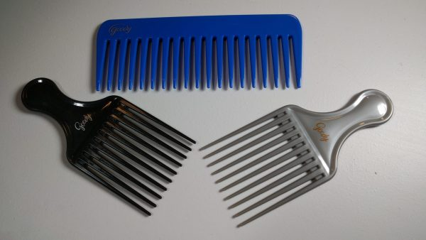 An image of a wide-tooth comb and two hair picks.