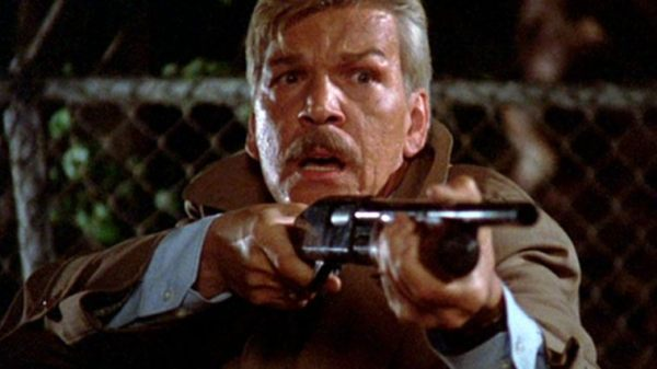 Tom Atkins pointing a gun in Night of the Creeps.