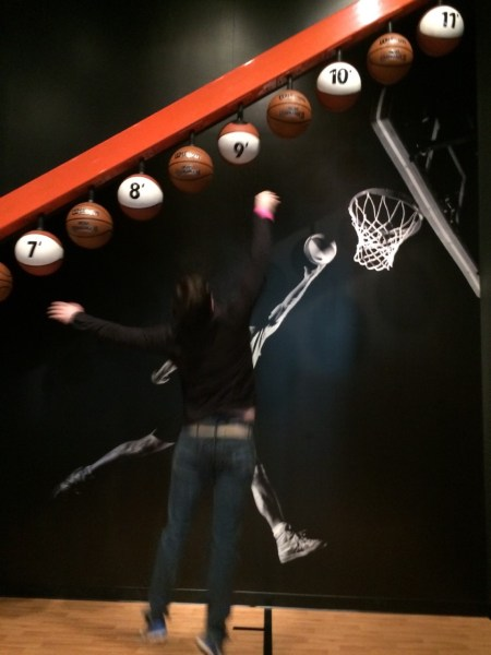 Hanging basketballs at various heights; someone is trying to jump straight up in the air to touch one