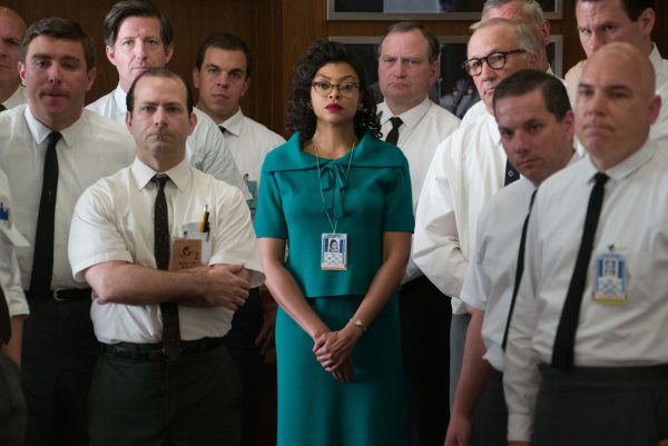 Katherine surrounded by white men