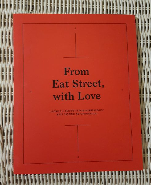 From Eat Street, With Love: The copy of the book is a classic fire engine red and centered on the cover is the title of the book. It's a soft cover.