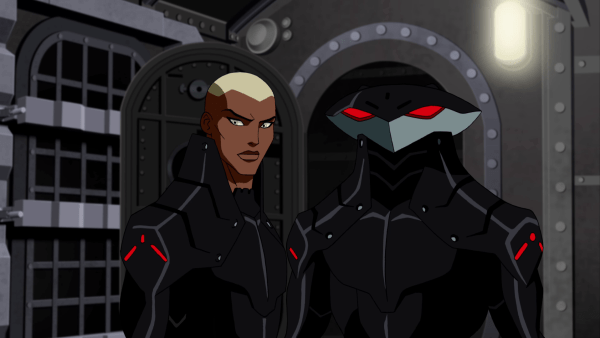 Kaldur'ahm and Black Manta side-by-side in matching black suits.