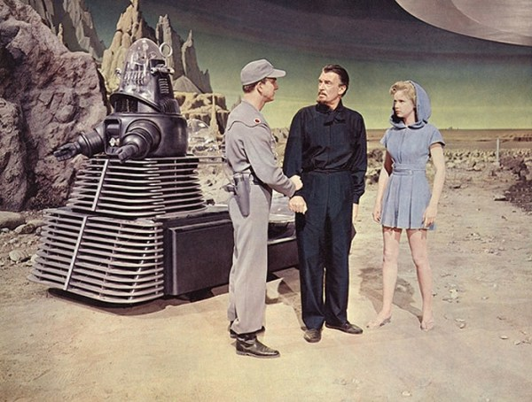 Dr. Morbius, Altaira, and Adams in front of Robby the Robot.