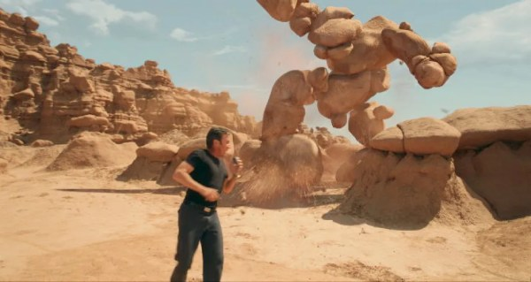 Tim Allen's character, Taggart, running from a rock monster.