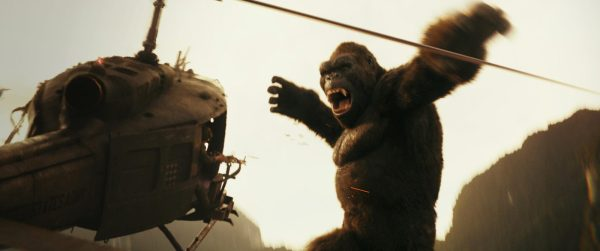 Kong makes a leaping swing at a helicopter