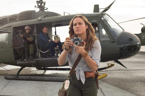 Brie Larson lining up a snapshot while exiting a helicopter