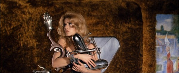 Barbarella holding weapons.