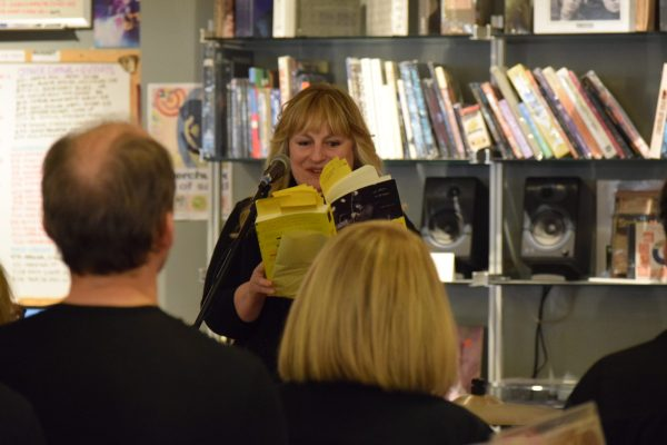 Cyn Collins reading an exceprt at her book launch in the Electric Fetus. Photo by Paul Patane
