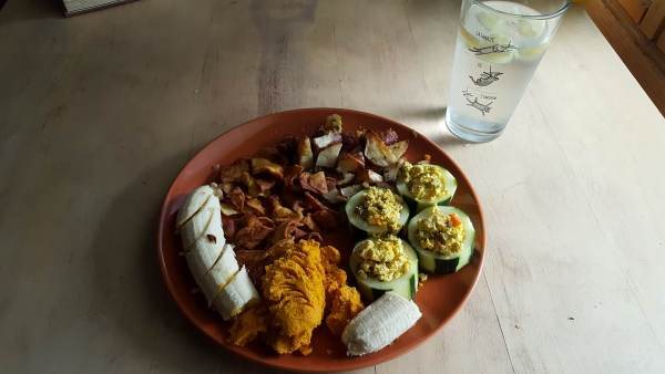 Roasted potatoes, cucumber cups, curried carrot dip, with a banana and plantain chips