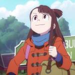 Akko, the protagonist of Little Witch Academia, looks off in the distance with a determined expression. She is wearing an orange jacket and carrying a brown bookbag on her left shoulder.
