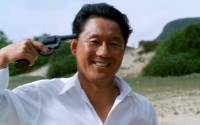 Murakawa (Takeshi Kitano) plays a friendly game of Russian Roulette