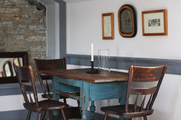 Historic table, chairs, and candestick