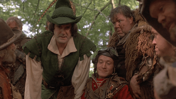 John Cleese as Robin Hood, talking to the dwarves.