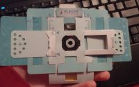 A Foldscope, blue pieces of stacked paper intricately woven together