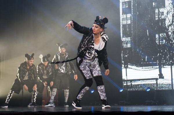Hip-hop dancers perform onstage