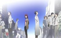 Kurisu and Okabe standing in the street amid passersby