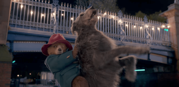 Paddington rides a dog to save the day.