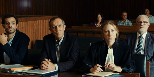 A still from a courtroom scene in The Insult