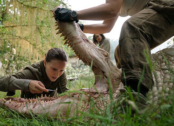 Lena examines a crocodile's mouth