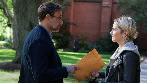 Ted and Angela exchange an envelope